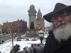 Rabbi Yaakov Rapoport with the menorah at Clinton Square