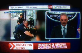 U.S. Attorney General Eric Holder announcing federal investigation.