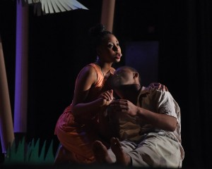 """A peasant girl Ti Moune, played by Tatyanna Jordan rescues a wealthy boy from the other side of the island, played by Carlos McArthur during he musical """"Once on This Island"""" performed at Fowler High School.  Photo by John Berry"""