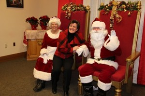 Mayor Miner with Mr. & Ms. Santa Claus in Mayor's Office