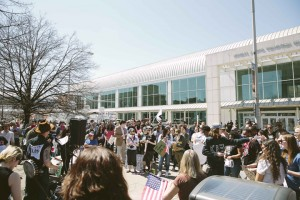 Protestors gather outside OnCenter Convention Center. photo by Amelia Beamish